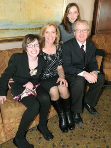 Pownal's Hannah MacLellan, left, poses with her parents Stephanie Drake and Rob MacLellan and her older sister Abbey, after giving her first speech Monday as the 2011 P.E.I. Easter Seals ambassador.
